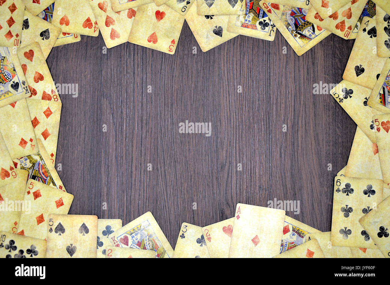Poker card background on wooden desk - Stock Image