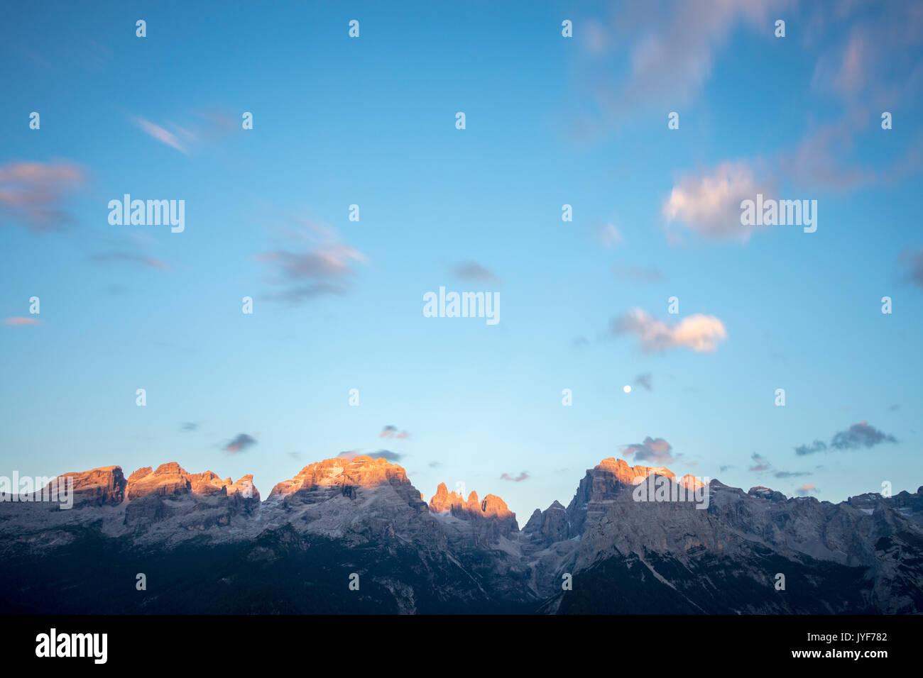 Sunset on the rocky peaks seen from Malga Ritorto Madonna di Campiglio Brenta Dolomites Trentino Alto Adige Italy Europe - Stock Image