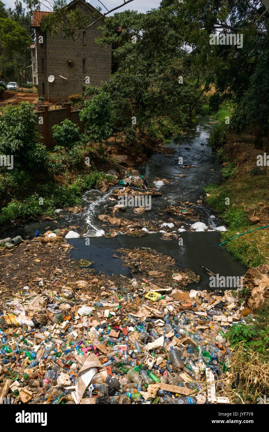 Plastic bottles and other waste rubbish blocking Nairobi river, Kenya - Stock Image