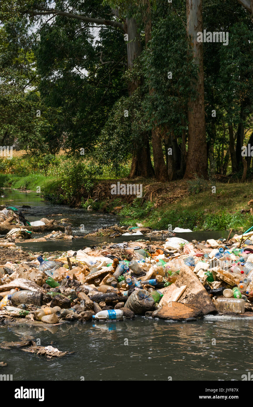 Plastic bottles and other waste rubbish blocking Nairobi river, Kenya - Stock Image