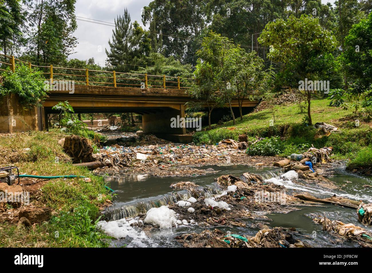 Plastic bottles and other waste rubbish blocking Nairobi river, Kenya Stock Photo