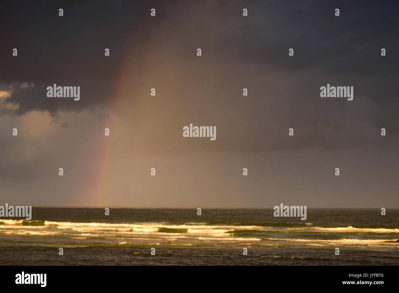 Rainbow over the Sea, Seven Mile Beach, New South Wales, Australia - Stock Image