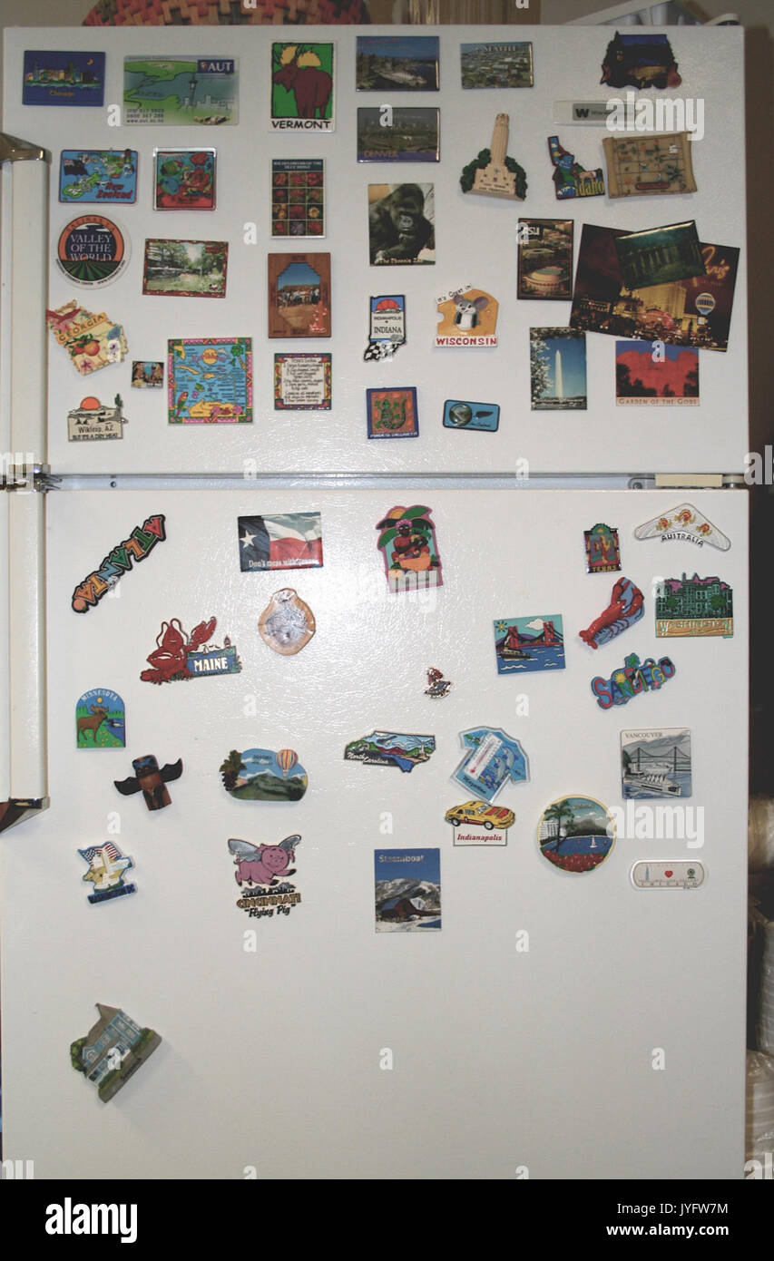 A few years ago I suggested to our office that whenever we travel for a conference, we return with a fridge magnet from the place we went to  the cheesier the better. (117804788) - Stock Image