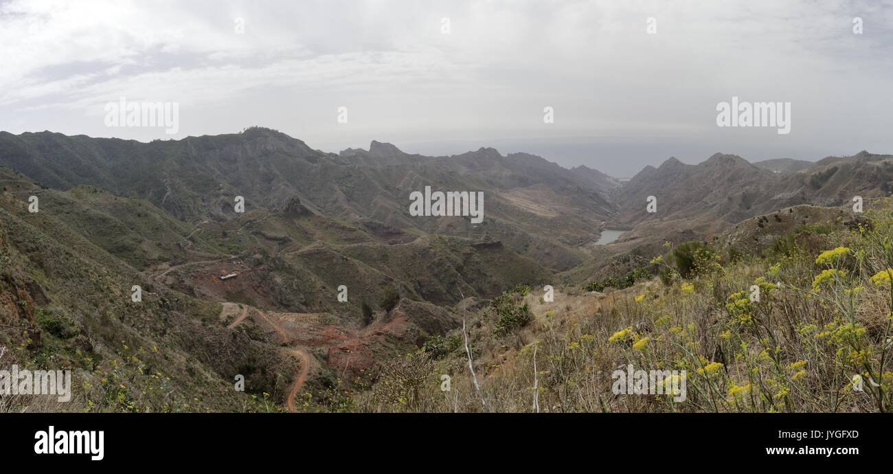 A landscape of Embalse del Tahodio  and the sea from the Anaga rural park on a cloudy day - Stock Image