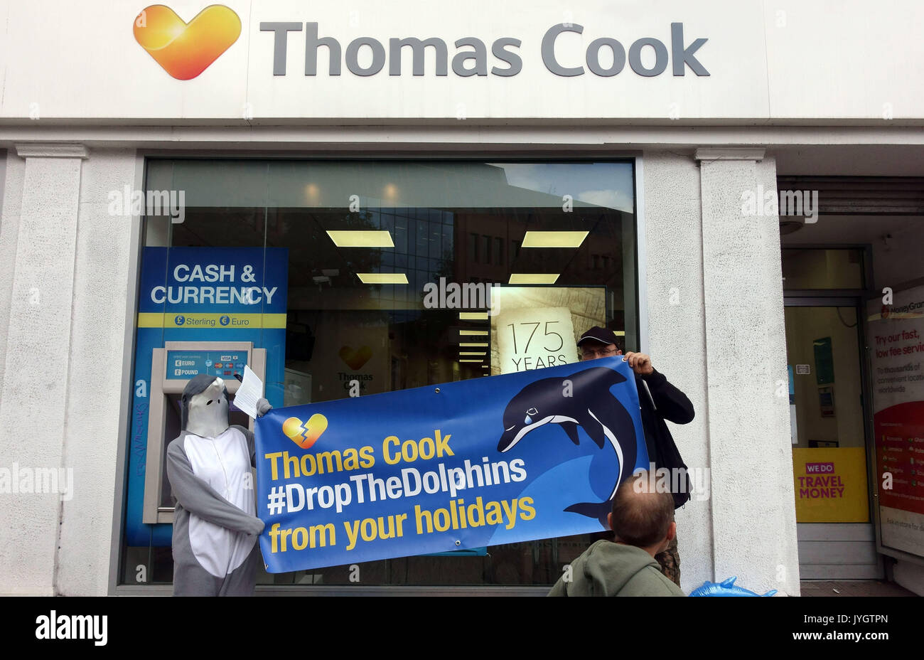 London, UK. 19th August, 2017.  Activists from Dolphin Freedom UK protest outside branch of Thomas Cook travel agents in Islington against 'cruel dolphin shows in Mexico and Caribbean'. The campaign claim that 'swim with dolphins' activities causes suffering to the sea animals. Please credit pictures by Jeffrey Blackler/Alamy Live News - Stock Image