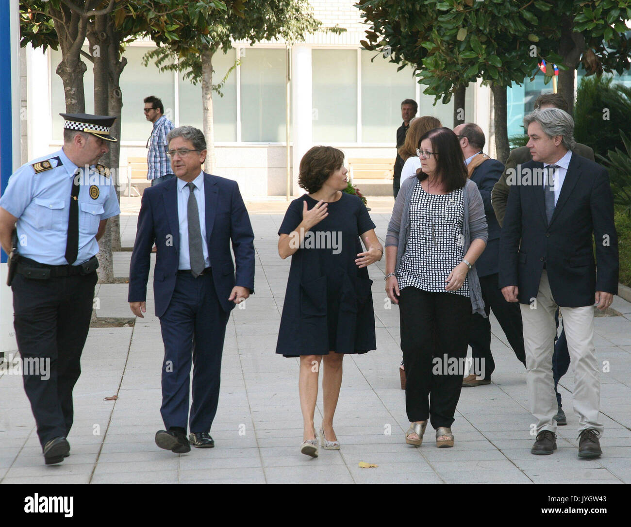 Spanish Deputy Prime Minister Soraya Saenz de Santamaria (C) visits the site of the terrorist attack, in Cambrils, Spain, 19 August 2017. At least 14 people have died and 130 were injured when a van crashed into pedestrians in Las Ramblas, downtown Barcelona in an incident which Spanish police are treating as a terror attack. Similar attack was conducted in coastal city of Cambrils, where five alleged terrorists, who apparently wore bomb belts, were shot dead by security forces on early morning 18 August after they attacked pedestrians using a vehicle next to a promenade, killing one and injur - Stock Image