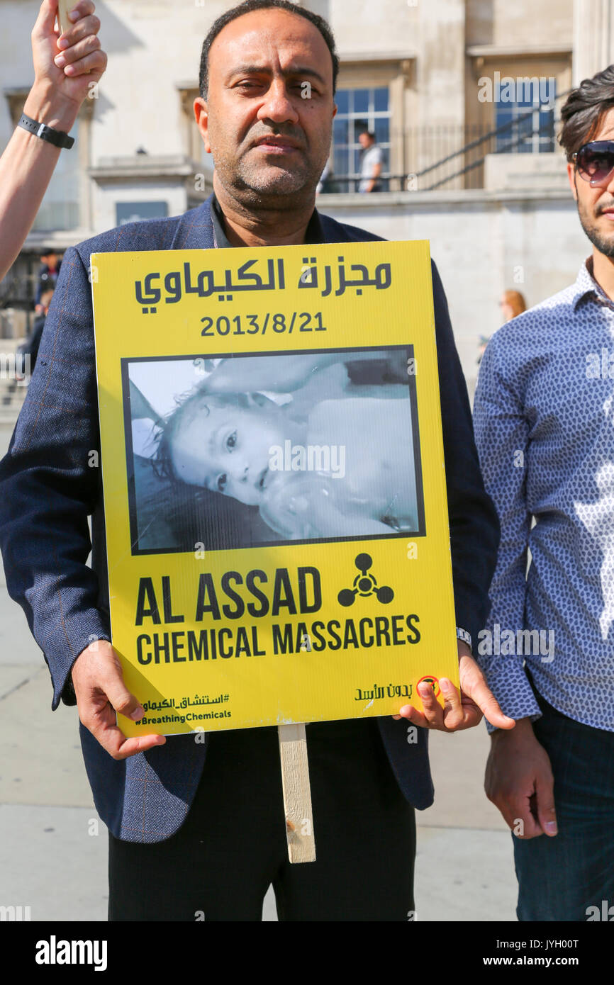 London, UK. 19th Aug, 2017. A small demonstration organised by Syria Solidarity Campaign in Trafalgar Square to mark the fourth anniversary of a chemical attack by the Assad regime in the towns of Zamalka and Ein Tarma in East Ghouta and Moadamiya in West Ghouta on the outskirts of Damascus, Syria. Nearly 1500 people died in the attacks. Penelope Barritt/Alamy Live news - Stock Image