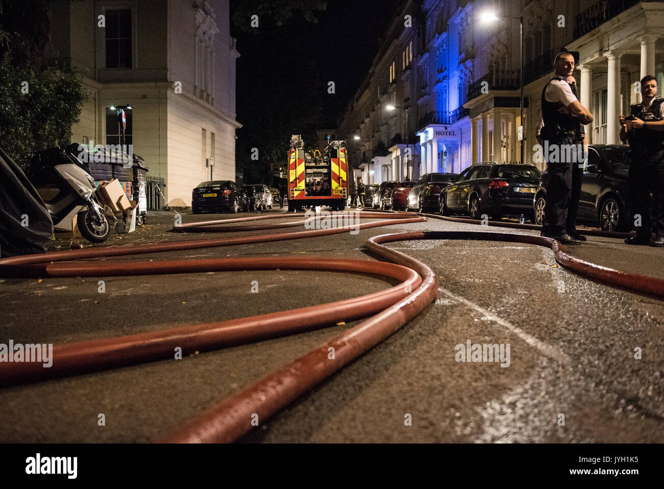 London, UK. 19th Aug, 2017. Eight fire engines and 58 firefighters were called to a flat fire on Kensington Gardens Square in Bayswater. The fire gutted two flats - one on the third floor and one on the fourth floor of the converted five storey mid-terraced town house. Credit: Peter Manning/Alamy Live News - Stock Image