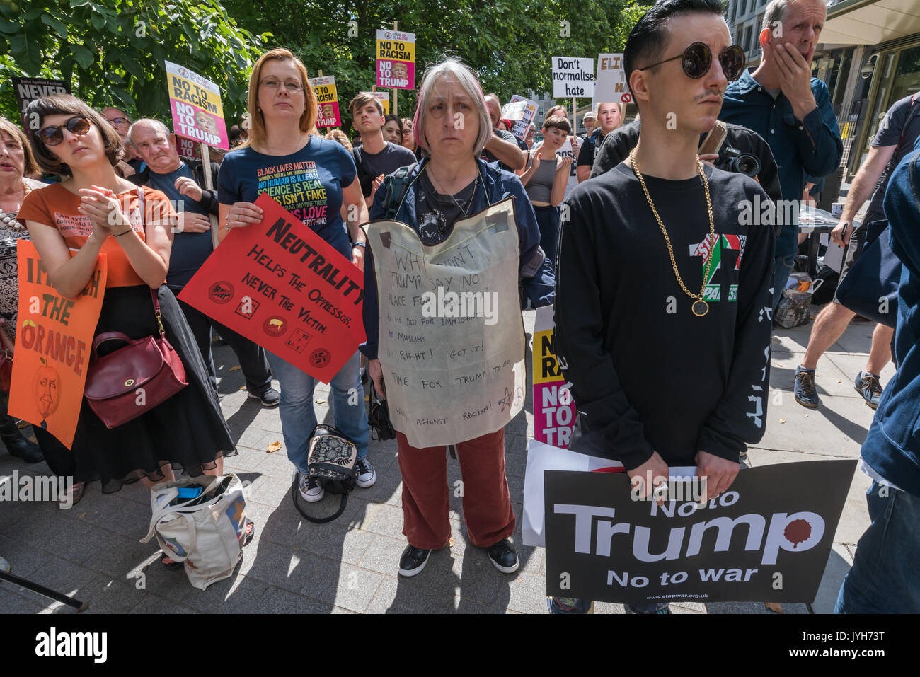 London, UK. 19th Aug, 2017. Stand Up to Trump, an organisation supported by around 20 organisations including the CWU, NUT, Unite, UCU, CND, Stop the War, Campaign Against Climate Change, Muslim Association of Britain and others protest outside the US Embassy. is support of climate-wreckin - Stock Image