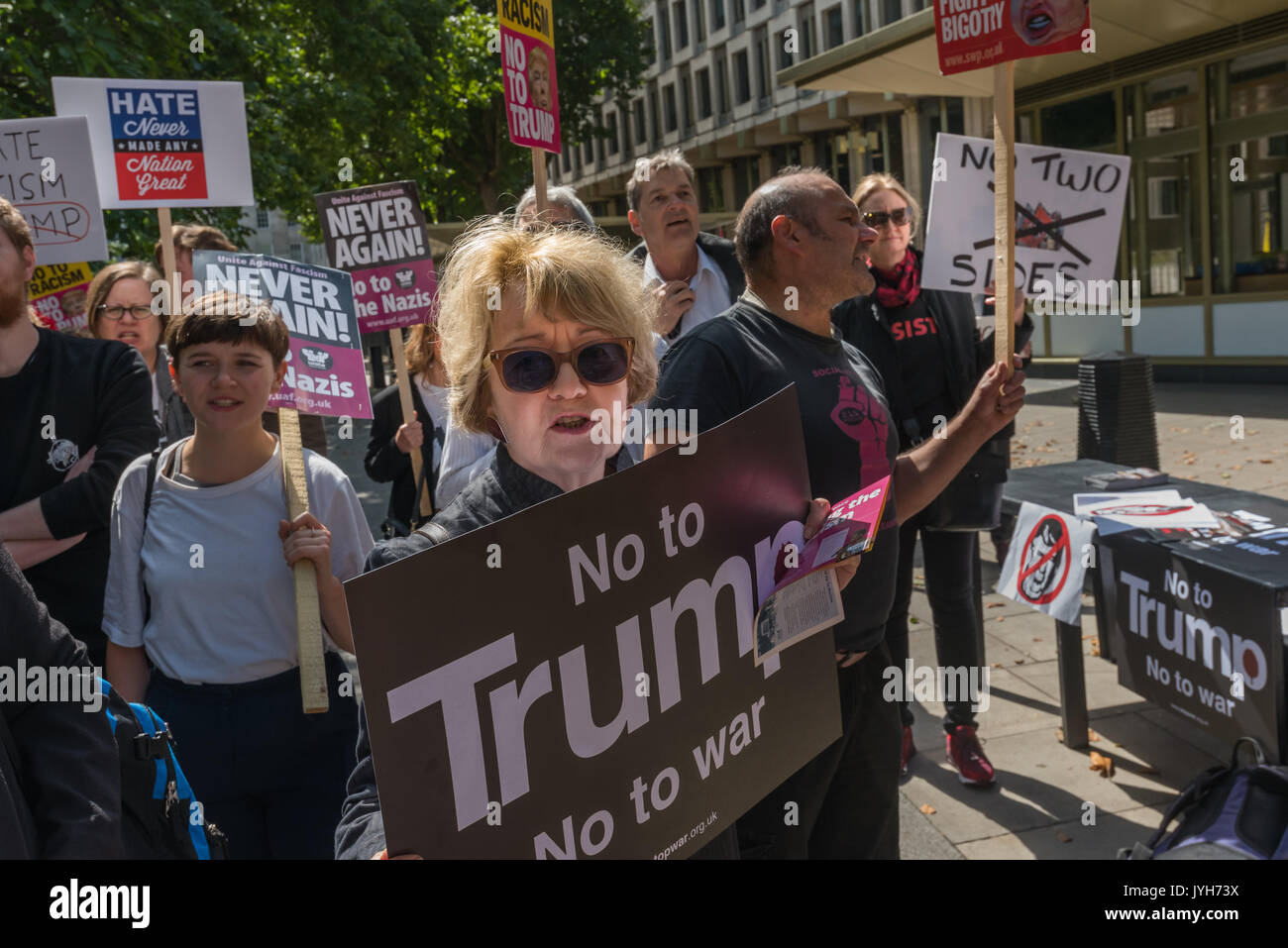 London, UK. 19th Aug, 2017. People at the Stand Up to Trump protest outside the US Embassy. The organisation is supported by around 20 organisations including the CWU, NUT, Unite, UCU, CND, Stop the War, Campaign Against Climate Change, Muslim Association of Britain and others. is suppor - Stock Image