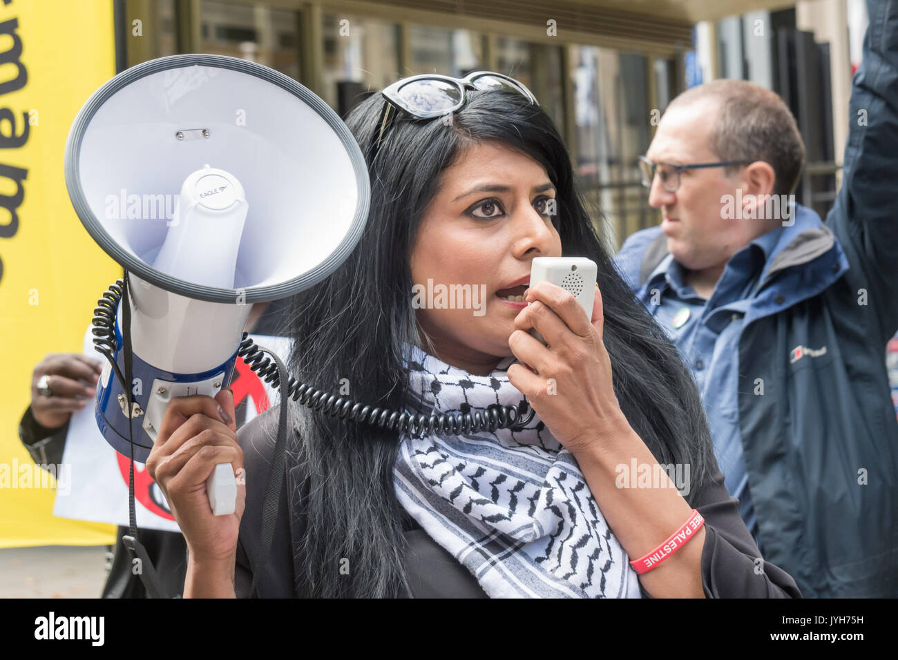 London, UK. 19th Aug, 2017. Shazia Khan whose father Mohammed Saleem was killed in a racist attack when walking home from a Birmingham mosque in 2013 speaks at the Stand Up to Trump protest outside the US Embassy. The organisation issupported by around 20 organisations including the CWU, NUT, Unite, UCU, CND, Stop the War, Campaign Against Climate Change, Muslim Association of Britain and others . They say Trump's bigoted rhetoric is sowing hate and division, encouraging extreme right-wing groups which is responsible for events such as those in Charlottesville - Stock Image