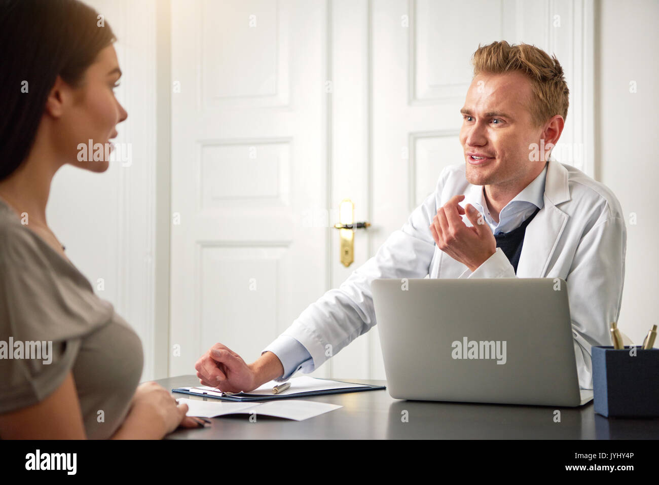 Spa And Beauty Specialist Man Sitting At Computer And Giving A Stock Photo Alamy