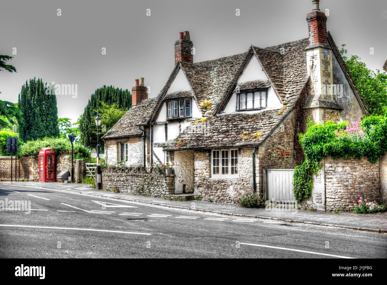 A traditional English roadside cottage at Lacock, Wiltshire, (processed as an hdr image). - Stock Image