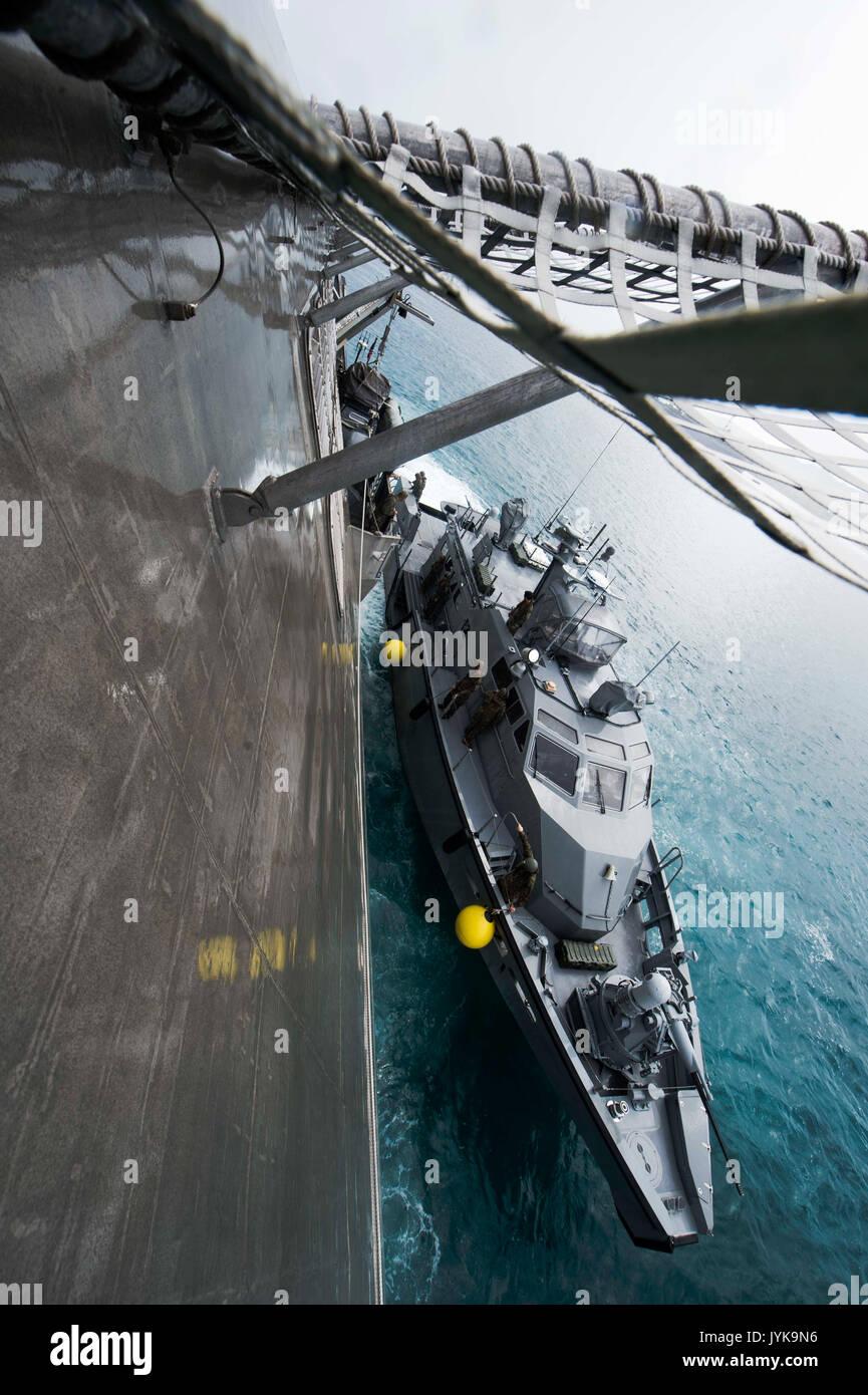A MK VI patrol boat, assigned to Coastal Riverine Group-1, pulls alongside the littoral combat ship USS Coronado Stock Photo