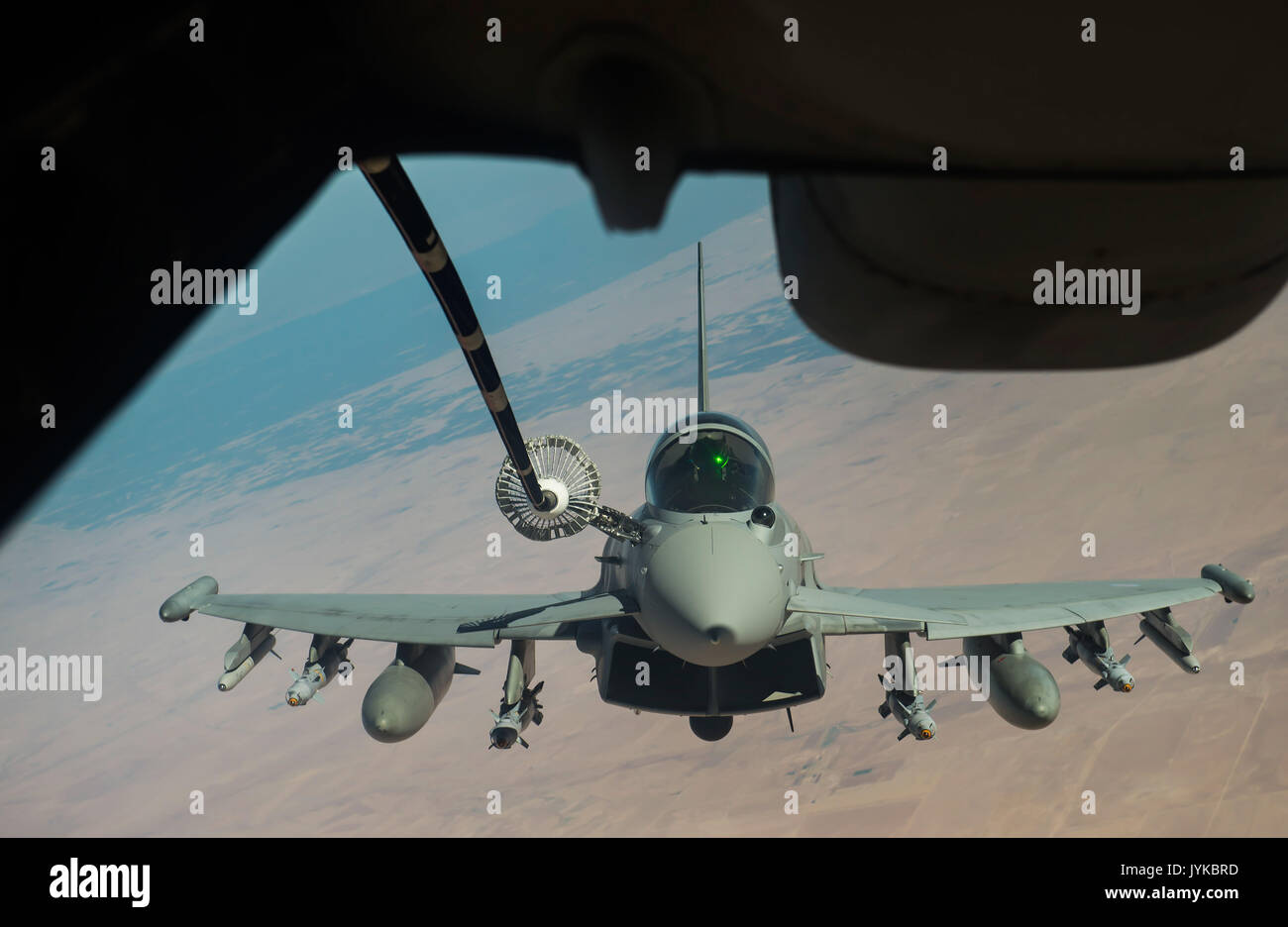 A Royal Air Force FGR4 Typhoon receives fuel from a KC-10 Extender during a mission in support of Operation Inherent Resolve, Aug. 7, 2017. The Typhoon provides the RAF with a highly capable and extremely agile multi-role combat aircraft, capable of being deployed in the full spectrum of air operations, including air policing, peace support, and high intensity conflict. (U.S. Air Force photo by Staff Sgt. Trevor T. McBride) - Stock Image