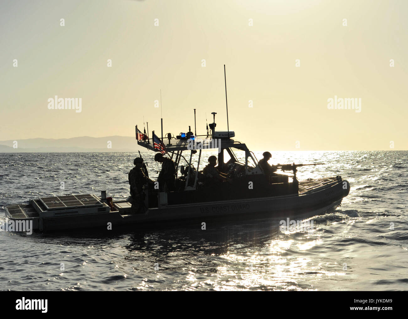 Coast Guardsmen from Port Security Unit 305 aboard a 32-foot Transportable Port Security Boat enforce a security Stock Photo