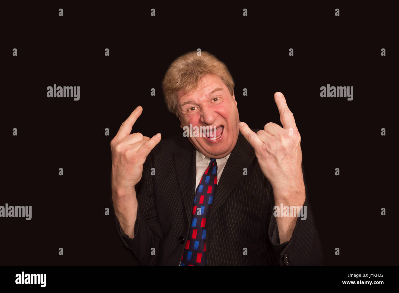 Devil hand sign stock photos devil hand sign stock images alamy elderly man making a horns gesture depicting heavy metal rock music stock image biocorpaavc Gallery