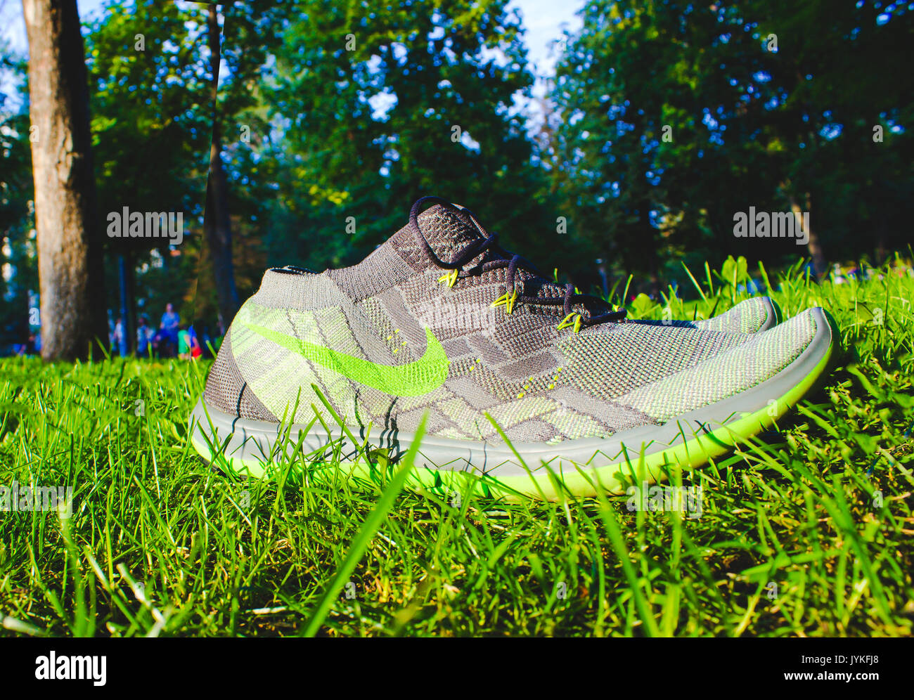 Dnipropetrovsk, Ukraine - August, 21 2016: New style nike shoes on green grass - illustrative editorial - Stock Image