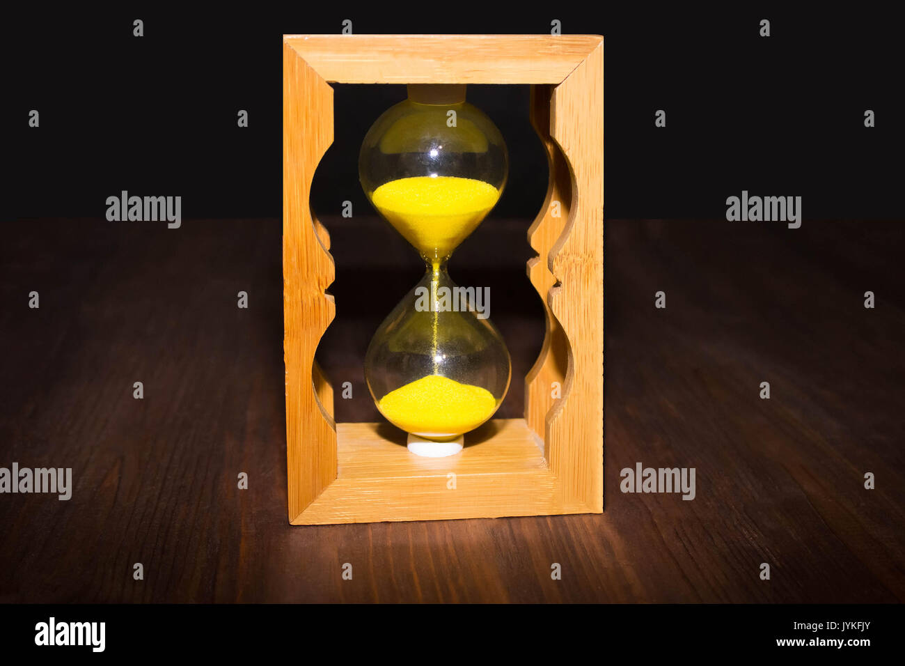 Hourglass as time passing concept for business deadline, urgency and running out of time. - Stock Image
