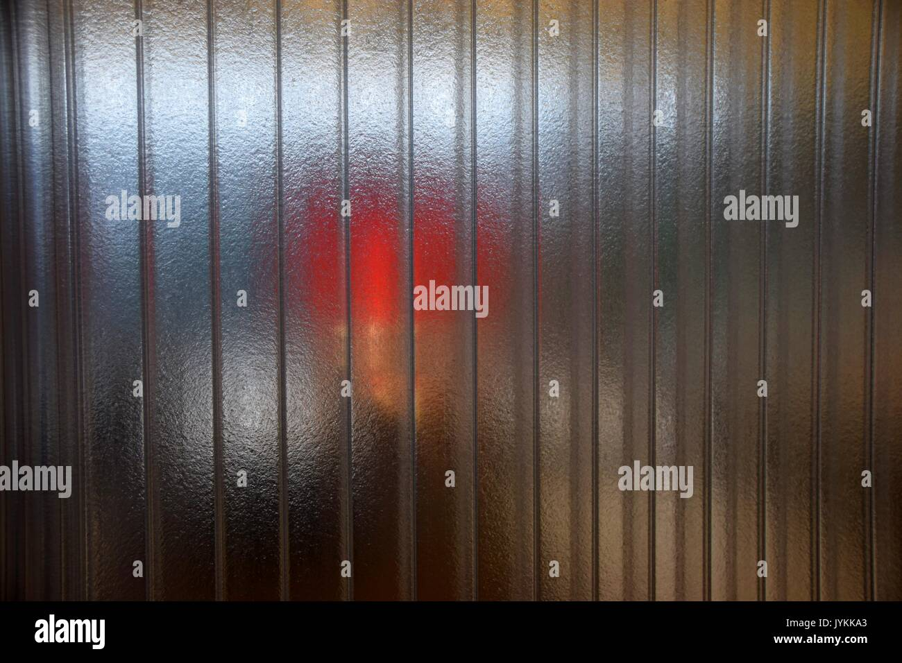clear plastic Partition wall with reflections, translucent wall, acrylic glass - Stock Image