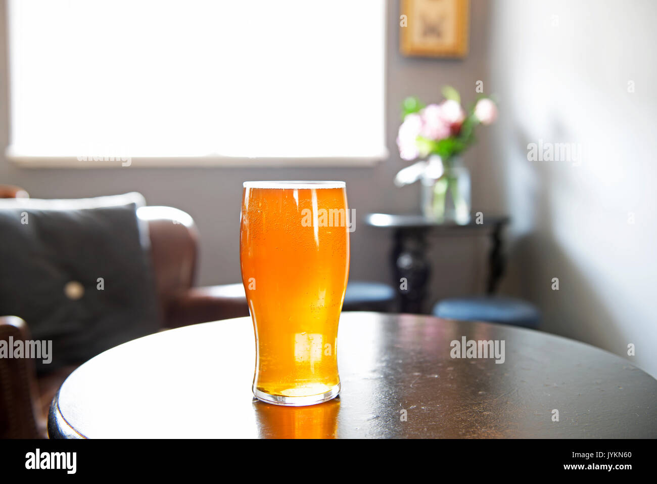 Pint of beer at the Lynn Arms in the village of Syderstone, Norfolk, England UK - Stock Image