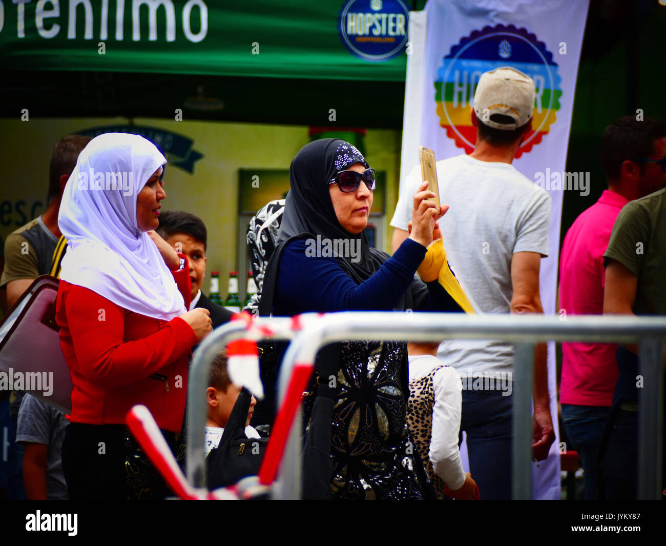 Muslim women photographing Germany German Munich CSD Christopher's Street Day Marriage for All party concert celebration - Stock Image