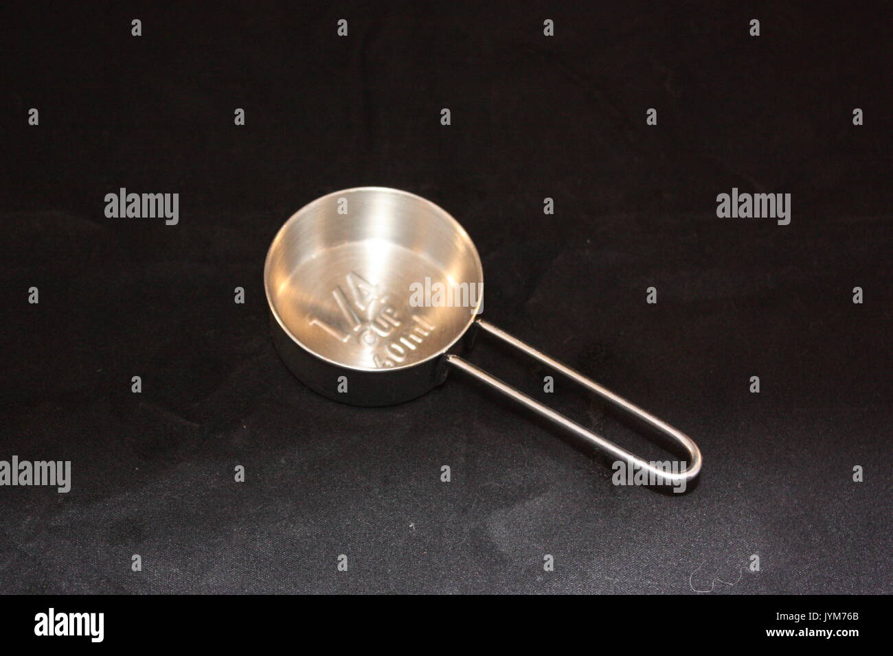 Stainless steel measuring spoon - Stock Image