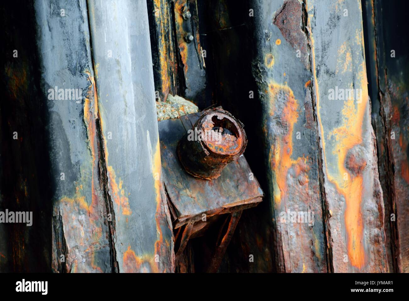 Sheet pile river wall with structural anchor showing anchor head in bad condition - Stock Image