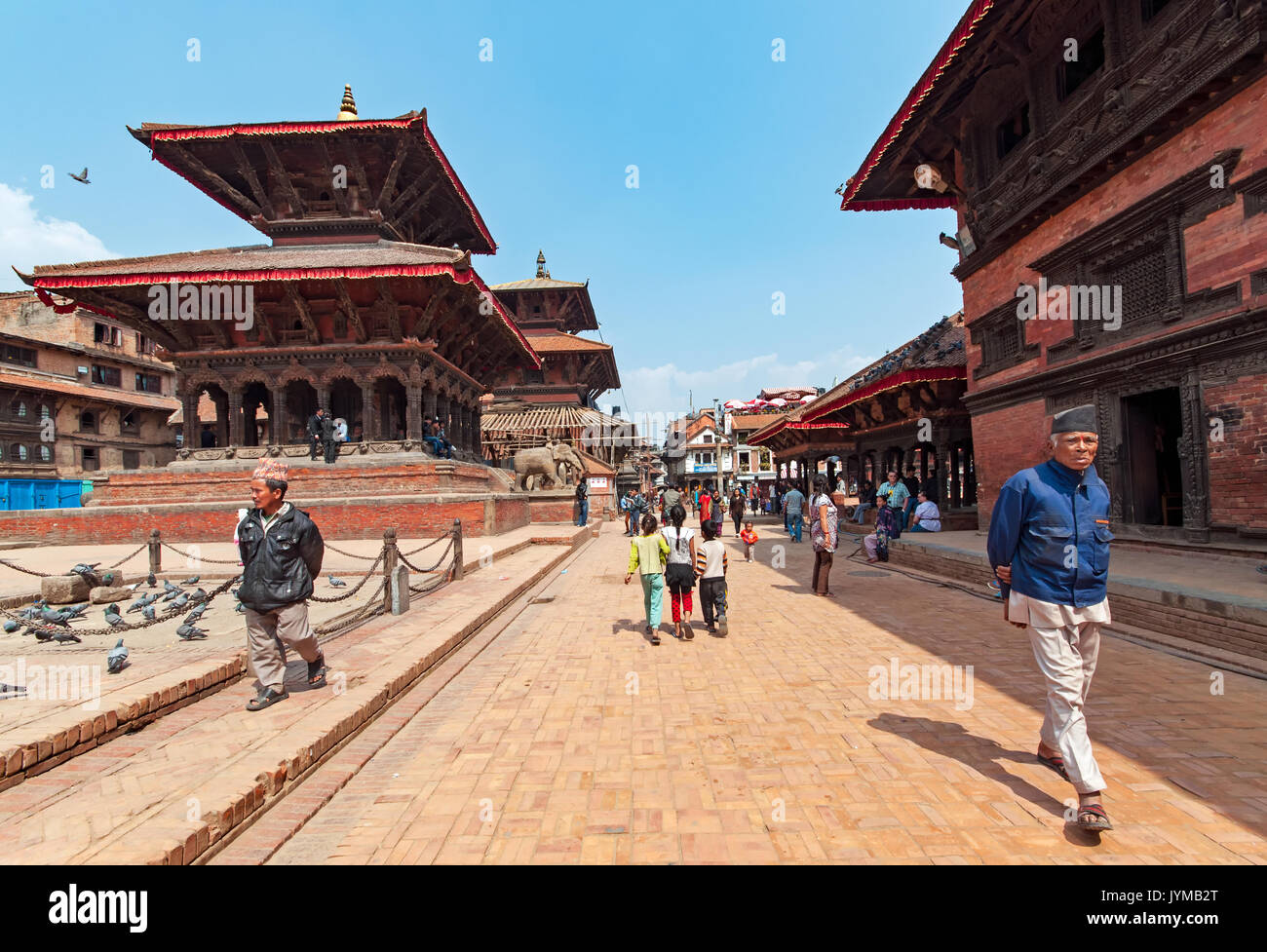 Kathmandu, Nepal - March 09, 2013: People walking at Kathmandu Durbar Square. Durbar Square is the generic name used to describe plazas and areas oppo - Stock Image