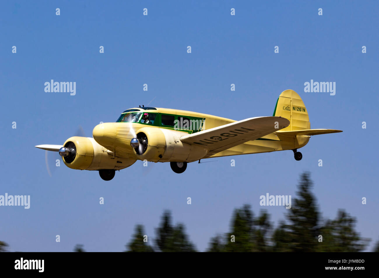 Twin engined Cessna T-50 Bobcat in flight during the 2017 Nevada County Airfest - Stock Image