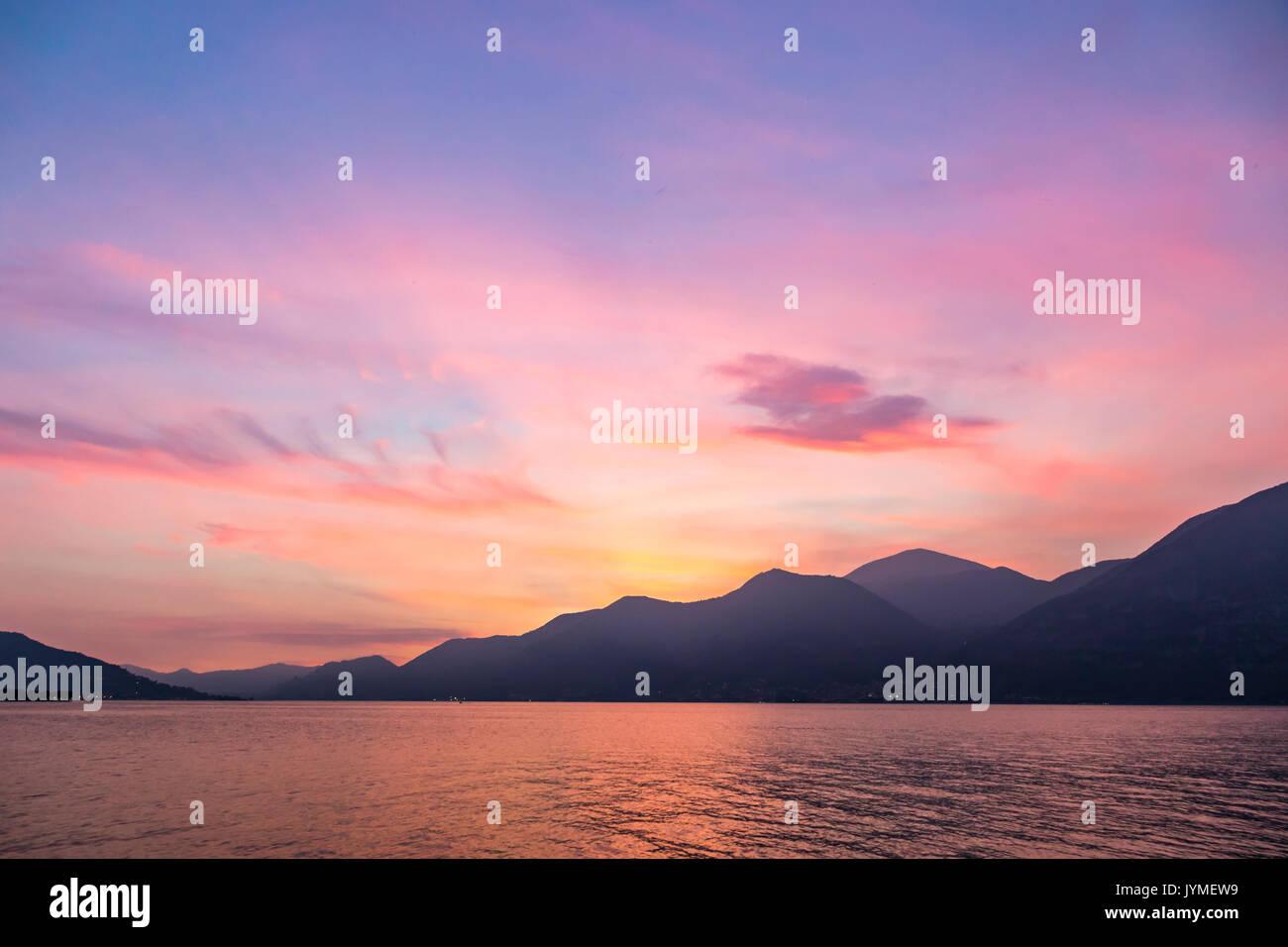 Beautiful foggy sunset at Iseo lake, Lombardy, Italy - Stock Image