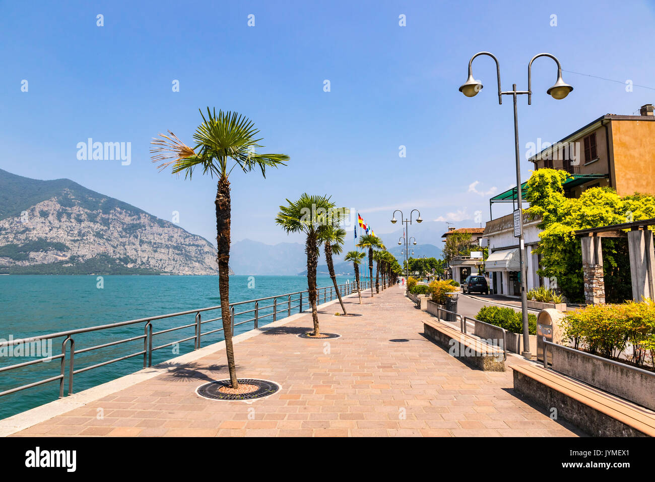 Promenade street in Iseo city on Iseo lake, Lombardy, Italy. Famous Italian resort. Lake Iseo (or Lago d'Iseo) is the 4th largest lake in Lombardy - Stock Image