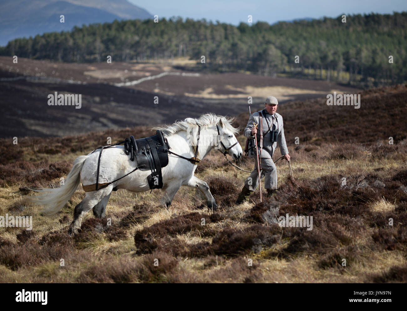 Hunter with a Rigby Stalker rifle deer stalking on the Blair Atholl estate in Scotland - Stock Image