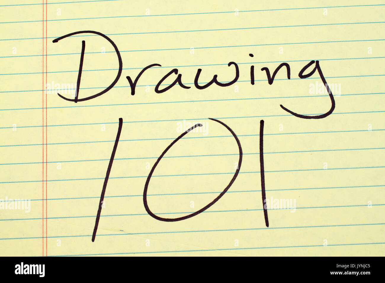 """The words """"Drawing 101"""" on a yellow legal pad Stock Photo"""