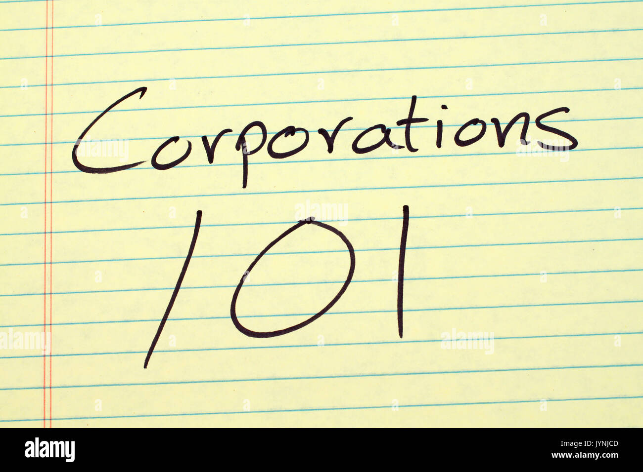 The words 'Corporations 101' on a yellow legal pad - Stock Image