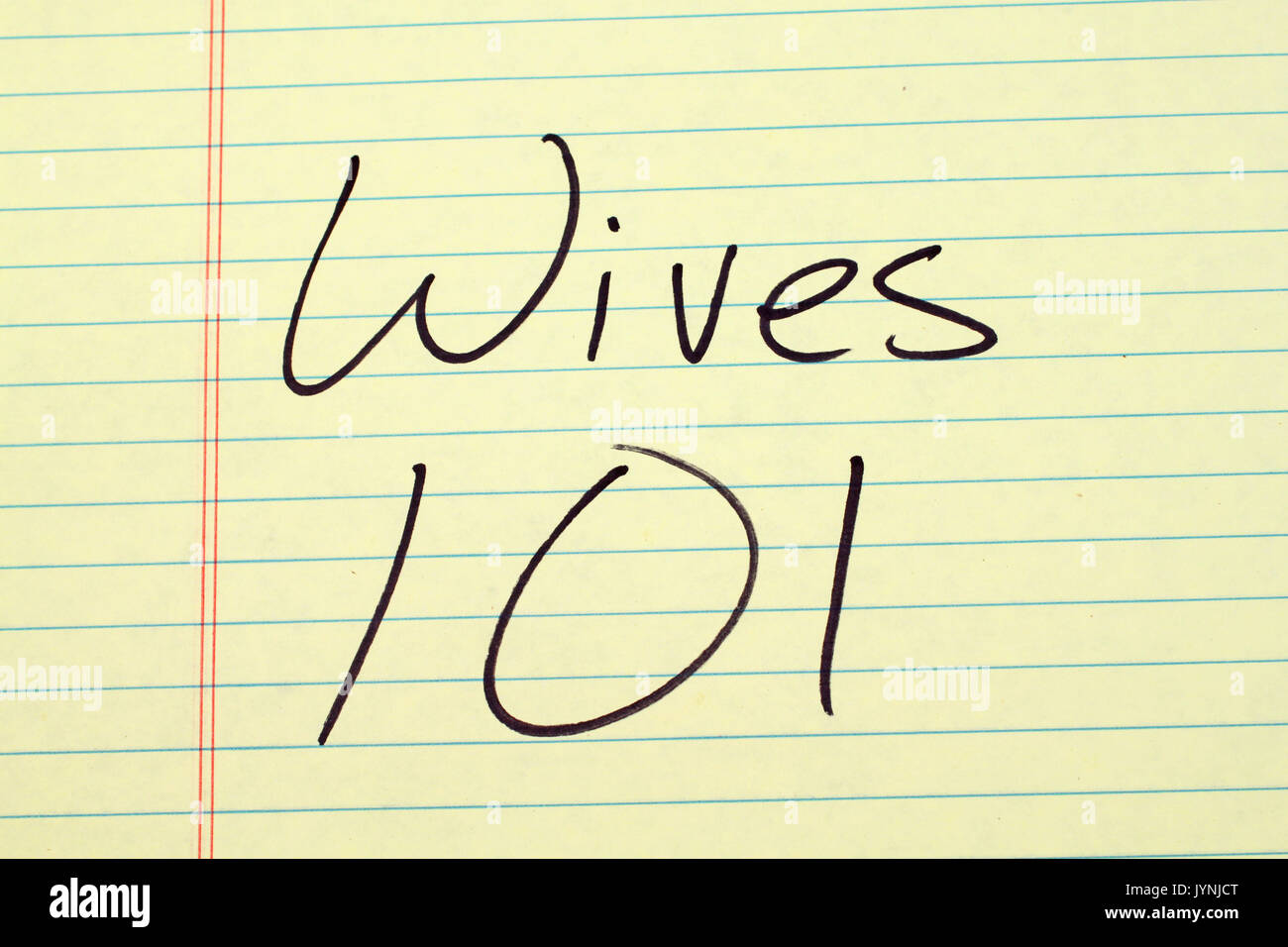 The words 'Wives 101' on a yellow legal pad - Stock Image
