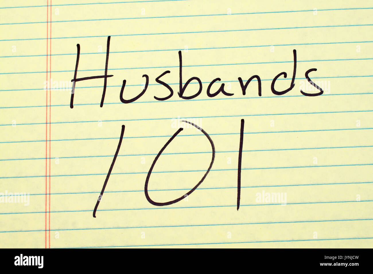 The words 'Husbands 101' on a yellow legal pad - Stock Image