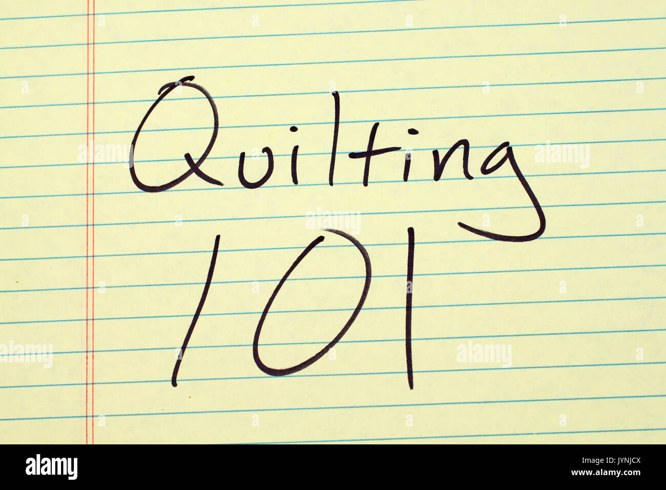 The words 'Quilting 101' on a yellow legal pad - Stock Image
