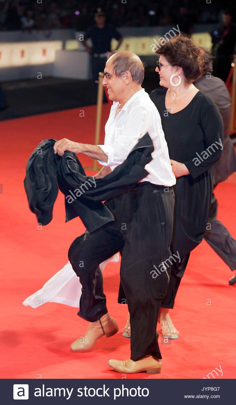 Claudia Mori and Adriano Celentano. Adriano Celentano and Claudia Mori stock photos. - Stock Image