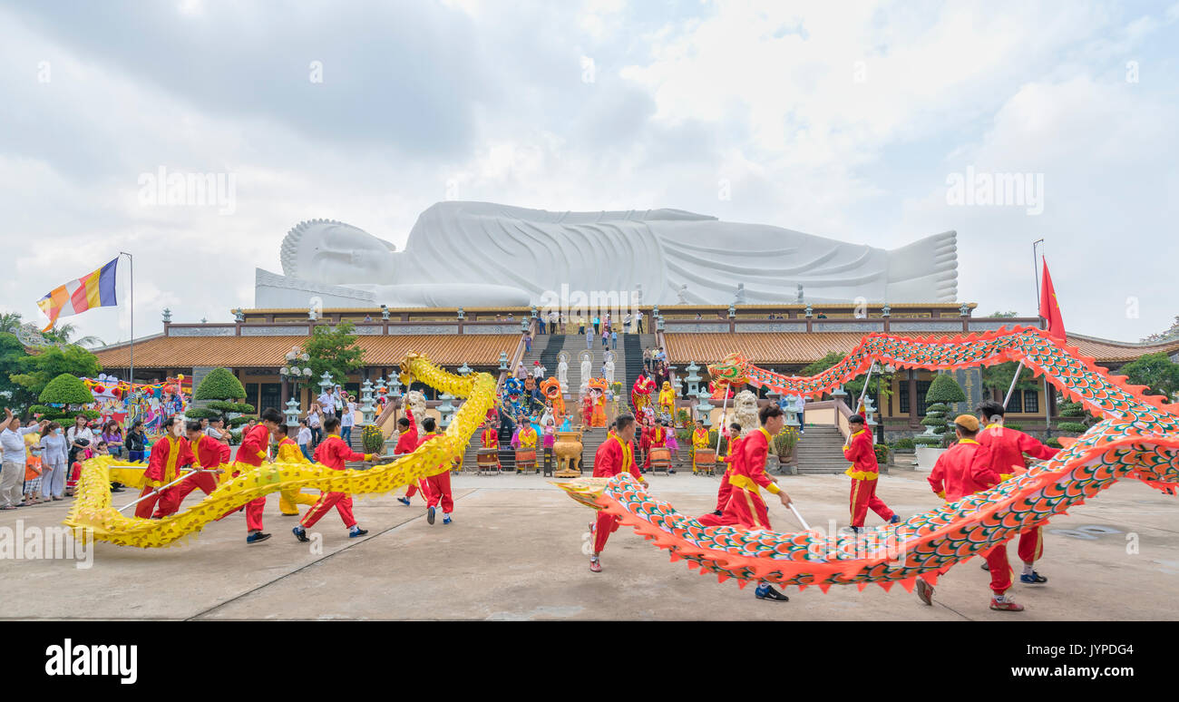 Festival in the old temple has beautiful architecture with the dragon dance martial arts students performed in Chinese Lantern Festival in Binh Duong, - Stock Image