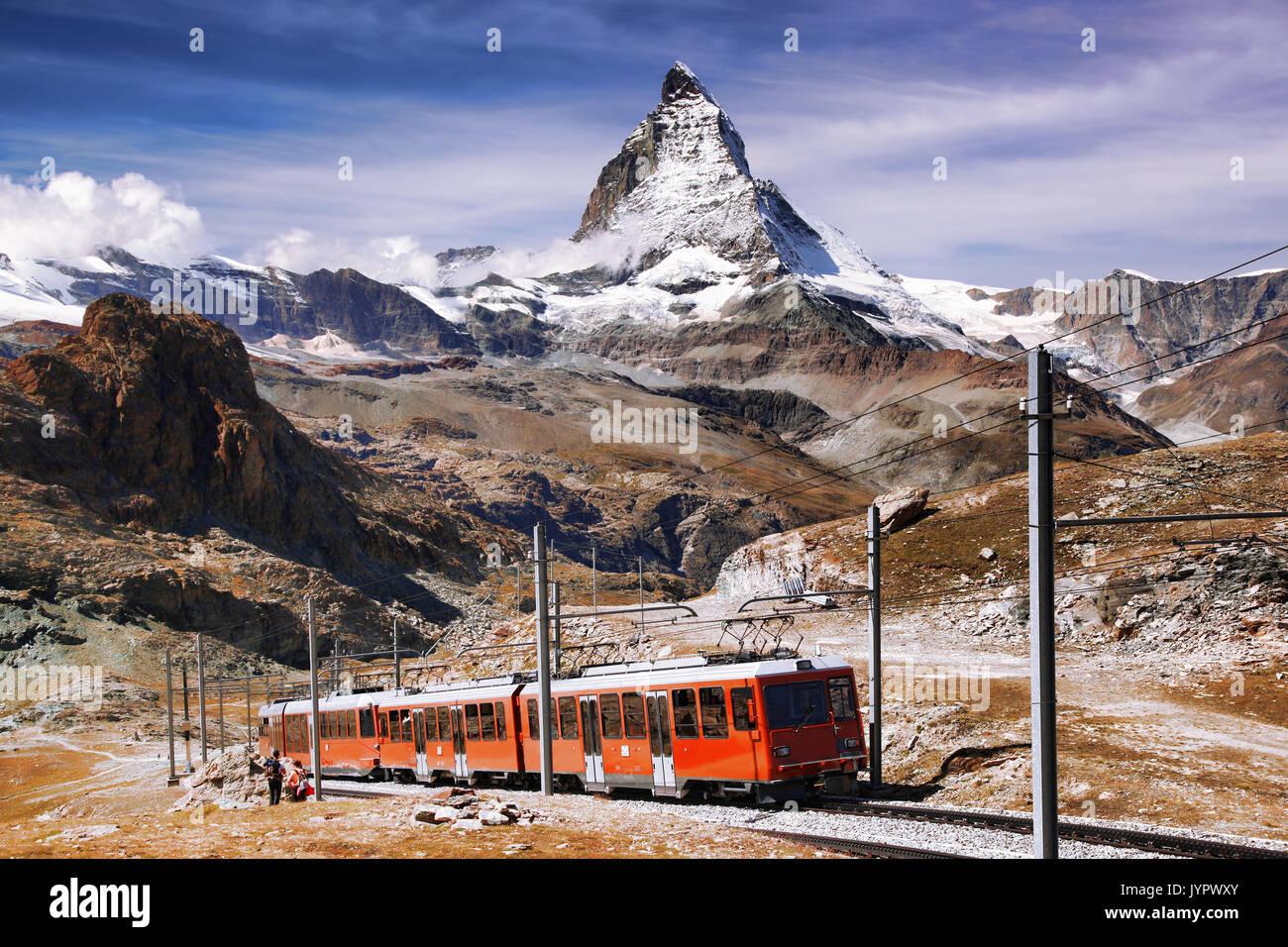 Famous Matterhorn peak with Gornergrat train in Swiss Alps, Switzerland - Stock Image