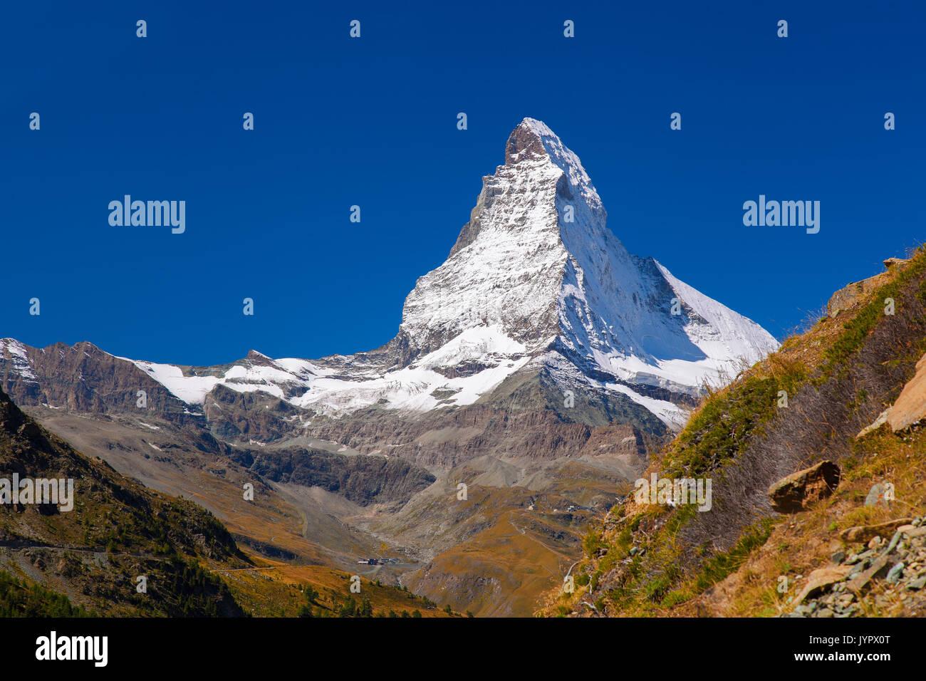 Matterhorn peak against blue sky in Swiss Alps, Zermatt area - Stock Image