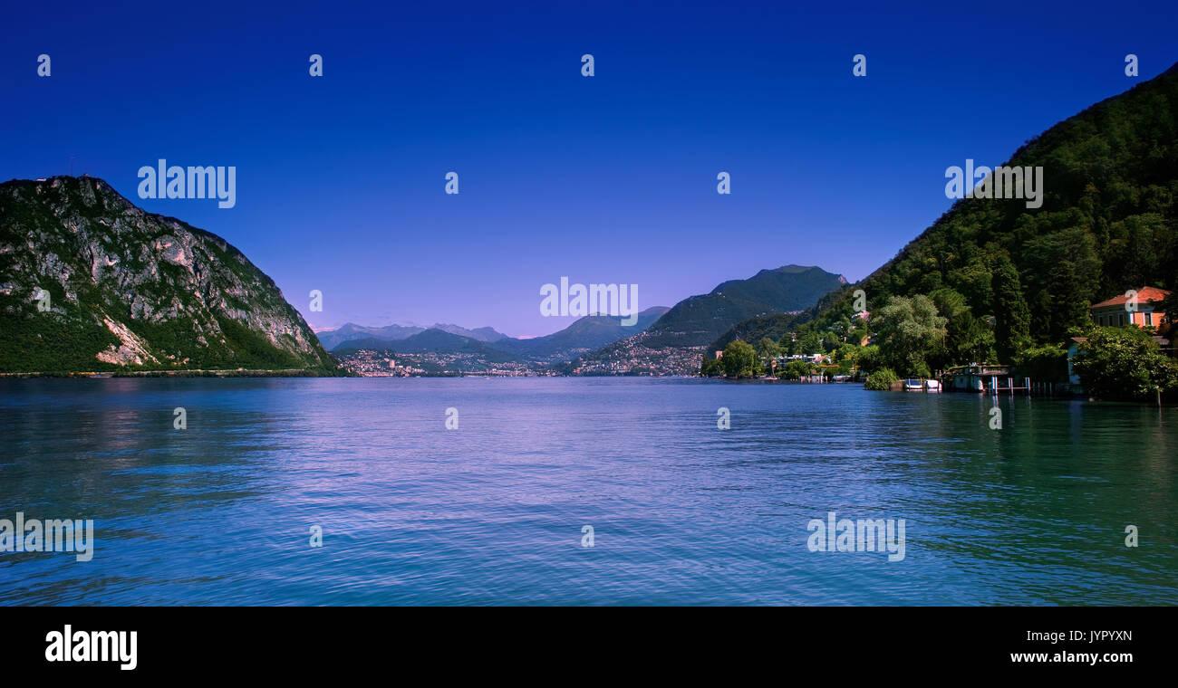 Photo of Lugano city shoreline and lake, Ticino, Switzerland. Stock Photo