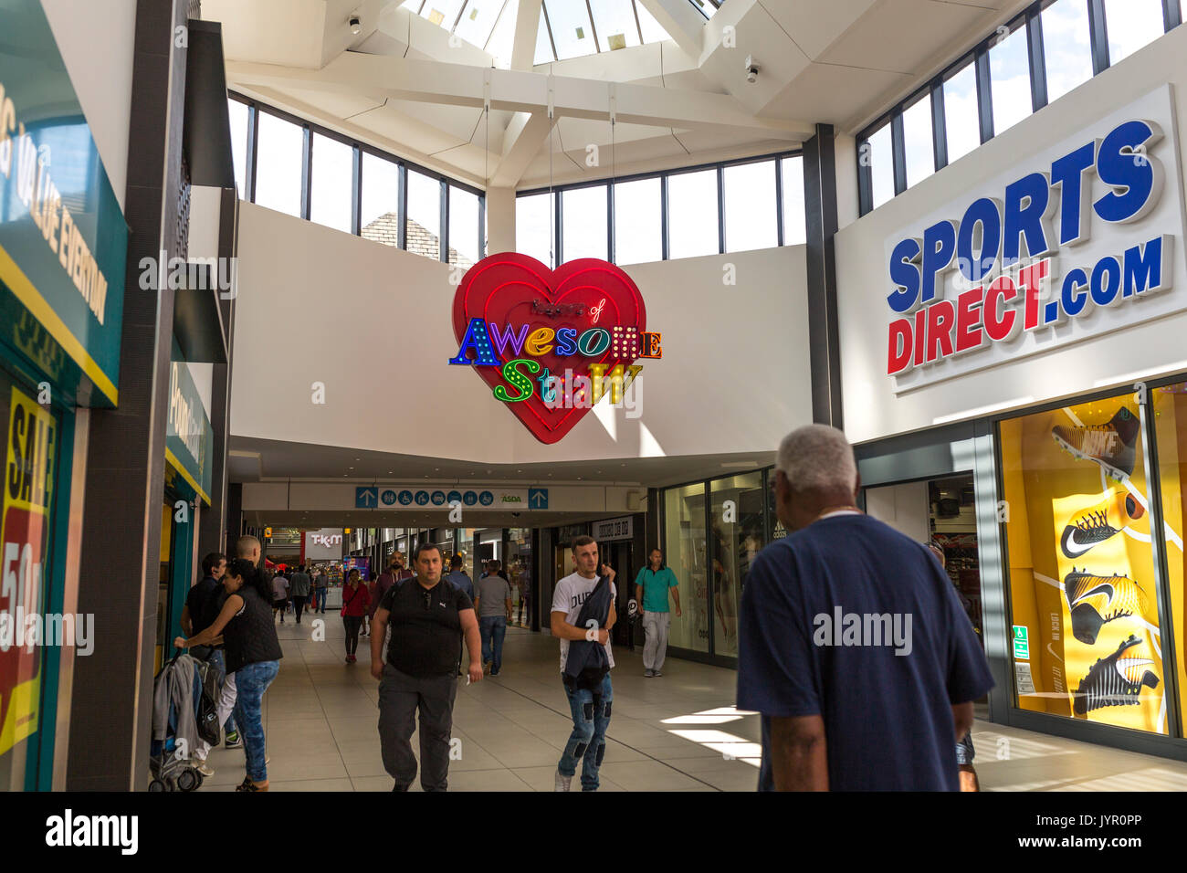 View of shops in The Mall, Walthamstow - with neon light in the style of God's Own Junkyard reading 'this is Awesomestow' - Stock Image