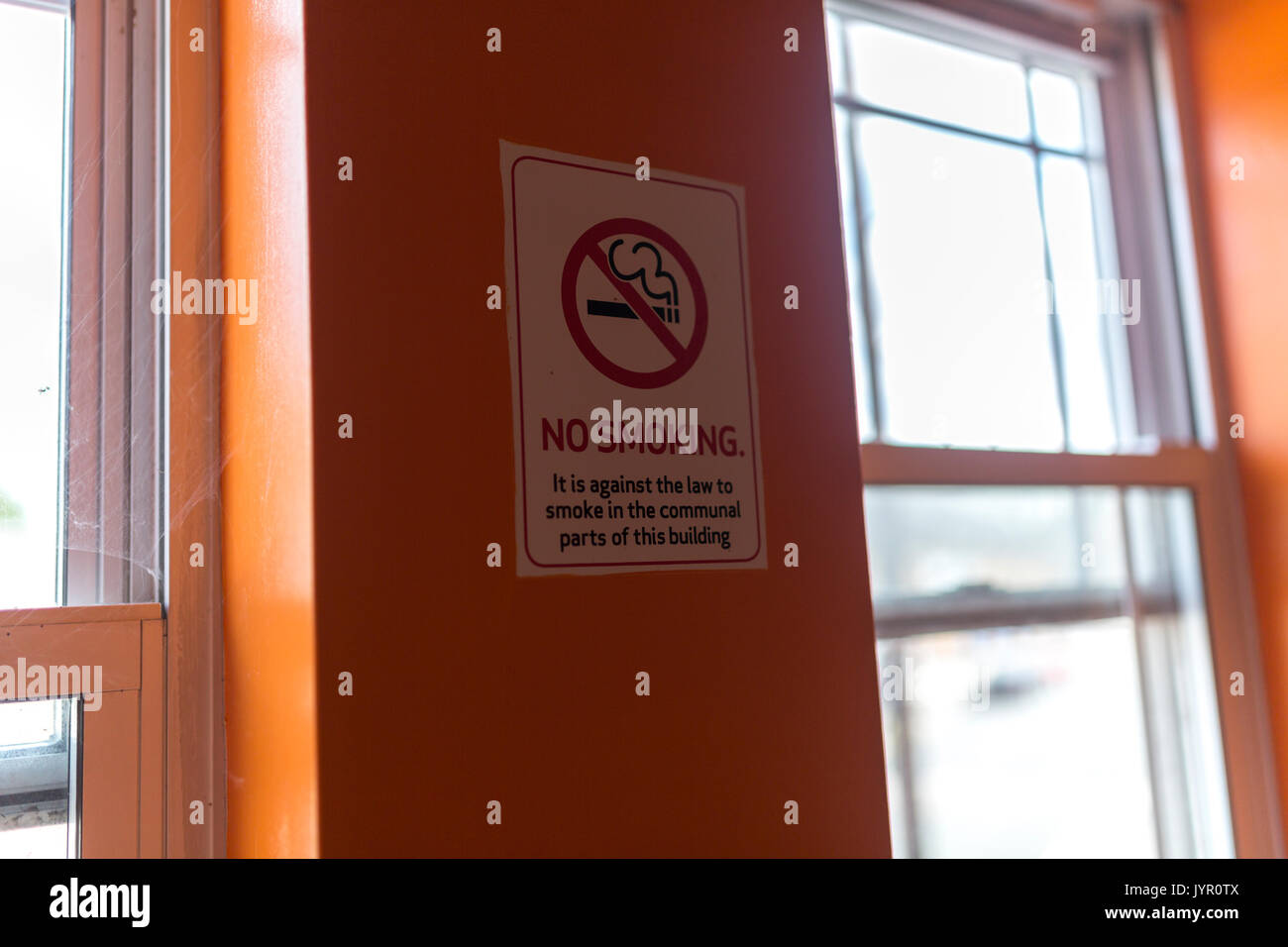 No Smoking sign on wall in stairwell of flats, London. Stock Photo