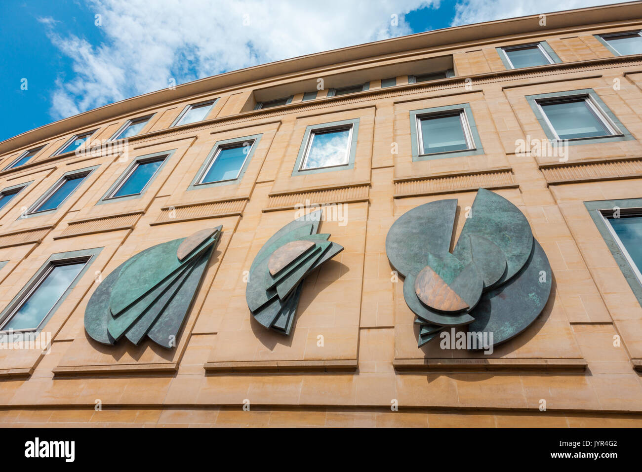 Building facade and bas relief sculpture on the outside wall, Clarence Street, Cheltenham, Glocestershire UK Stock Photo