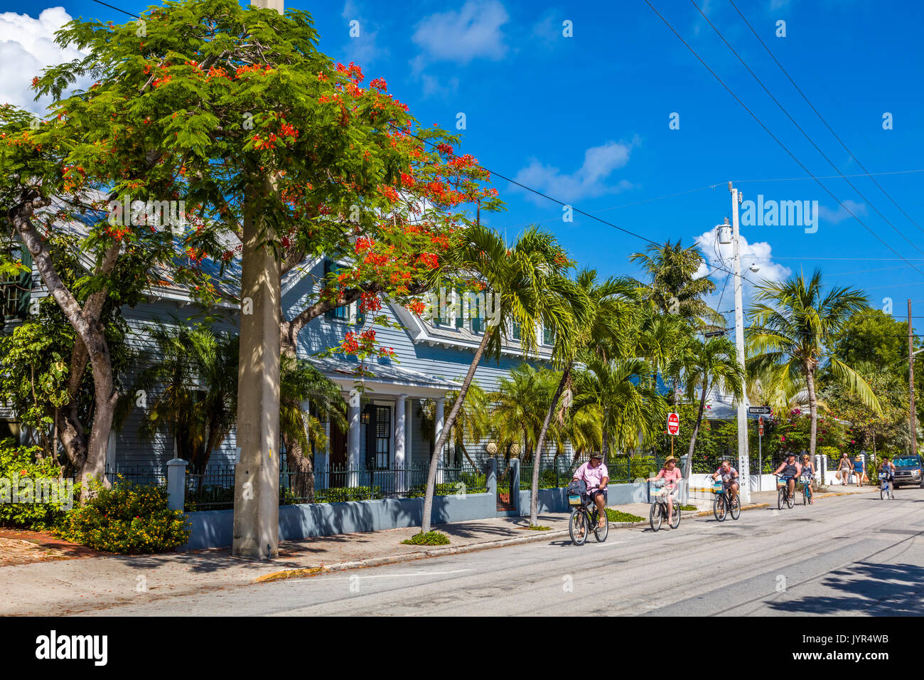 People riding bikes in Key West Florida - Stock Image