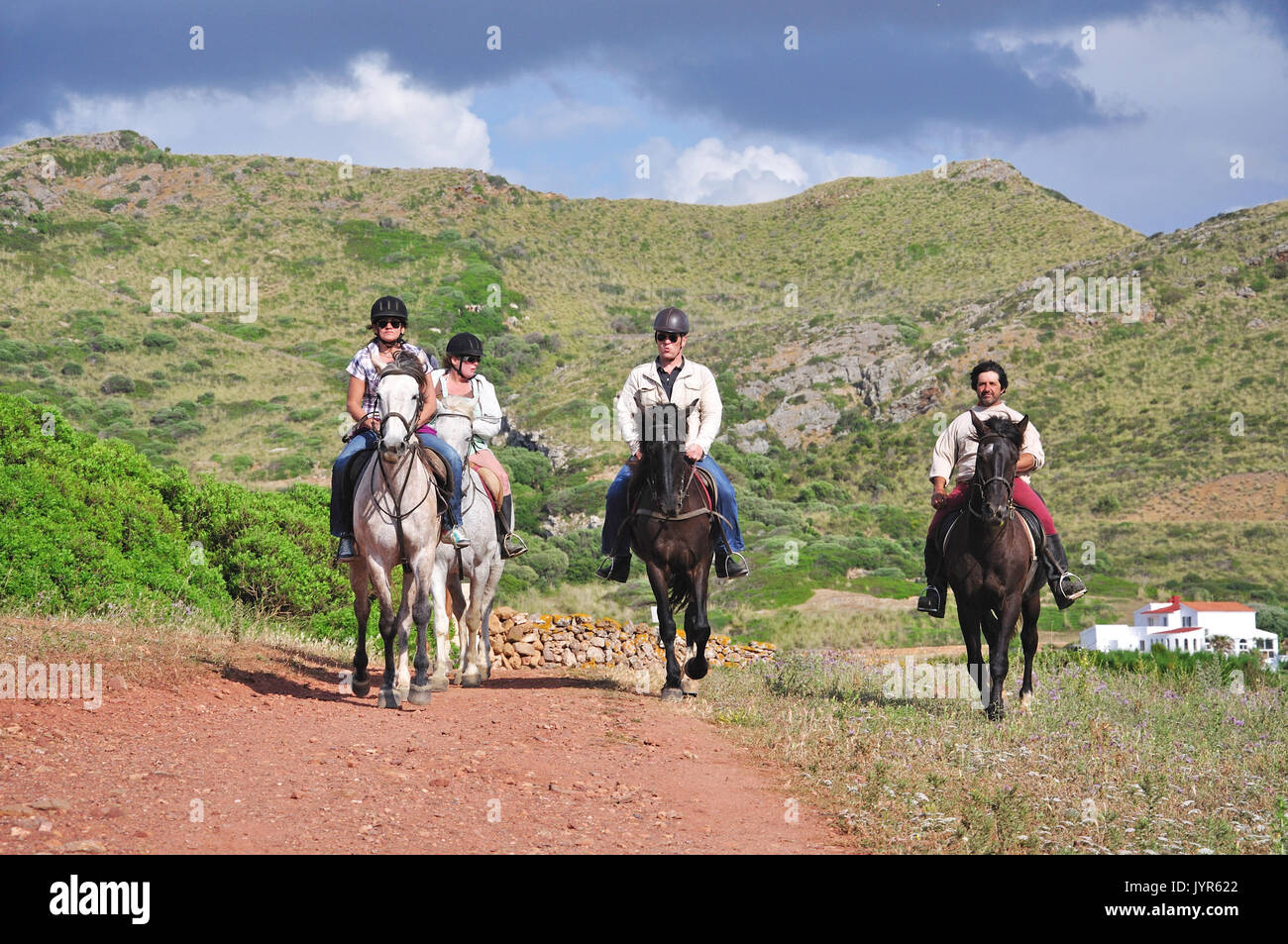 Horse riding trek to Cala Pregonda, Es Mercadal, Menorca, Balearic Islands, Spain - Stock Image