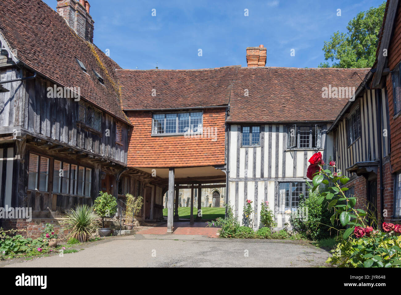 Timber-framed courtyard in front of St John the Baptist Church, Rogues Hill, Penshurst, Kent, England, United Kingdom - Stock Image