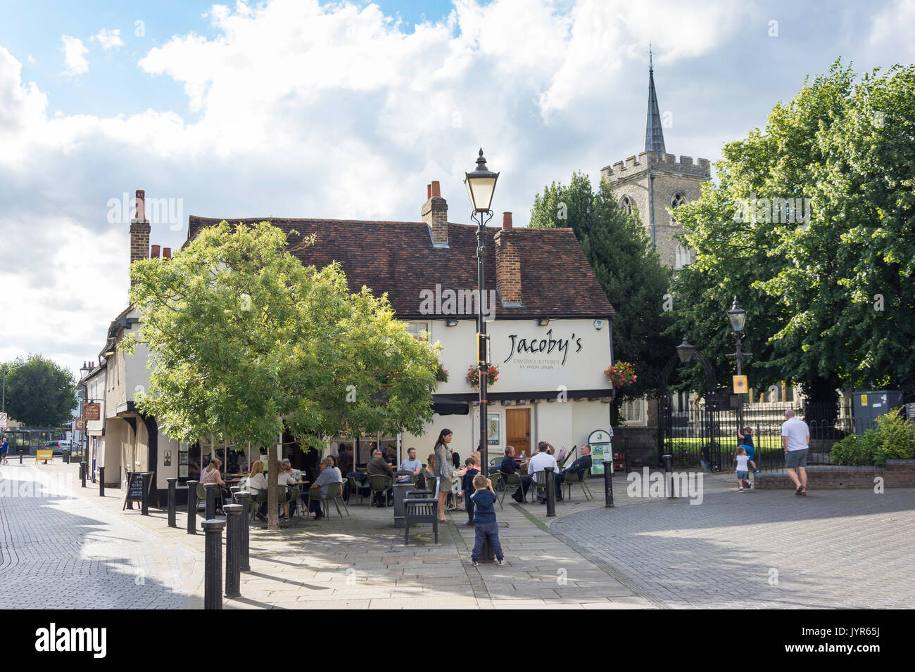 Jacoby's Restaurant and St.Mary's Church, Tudor Square, Ware, Hertfordshire, England, United Kingdom - Stock Image
